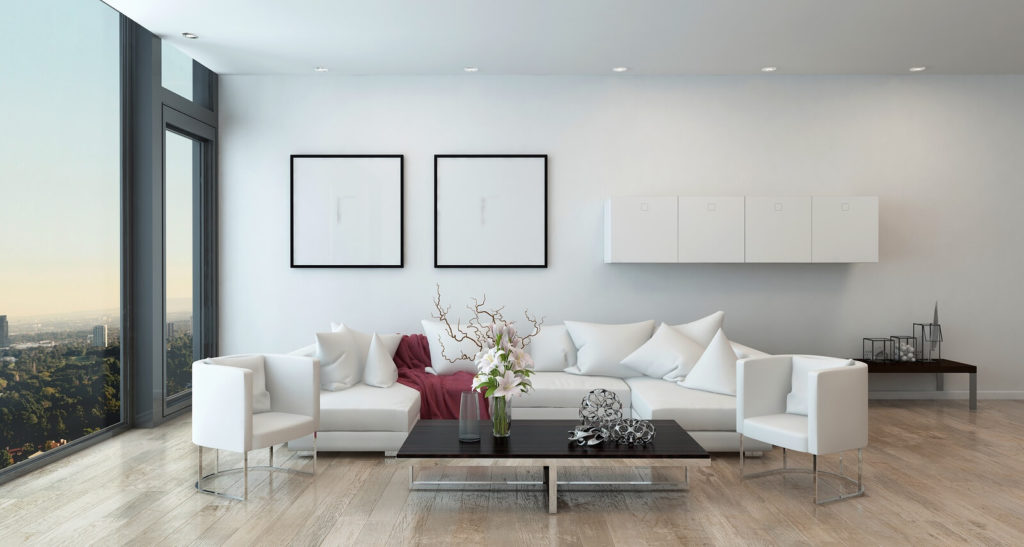interior of an urban condominium with a white sofa and low coffee table
