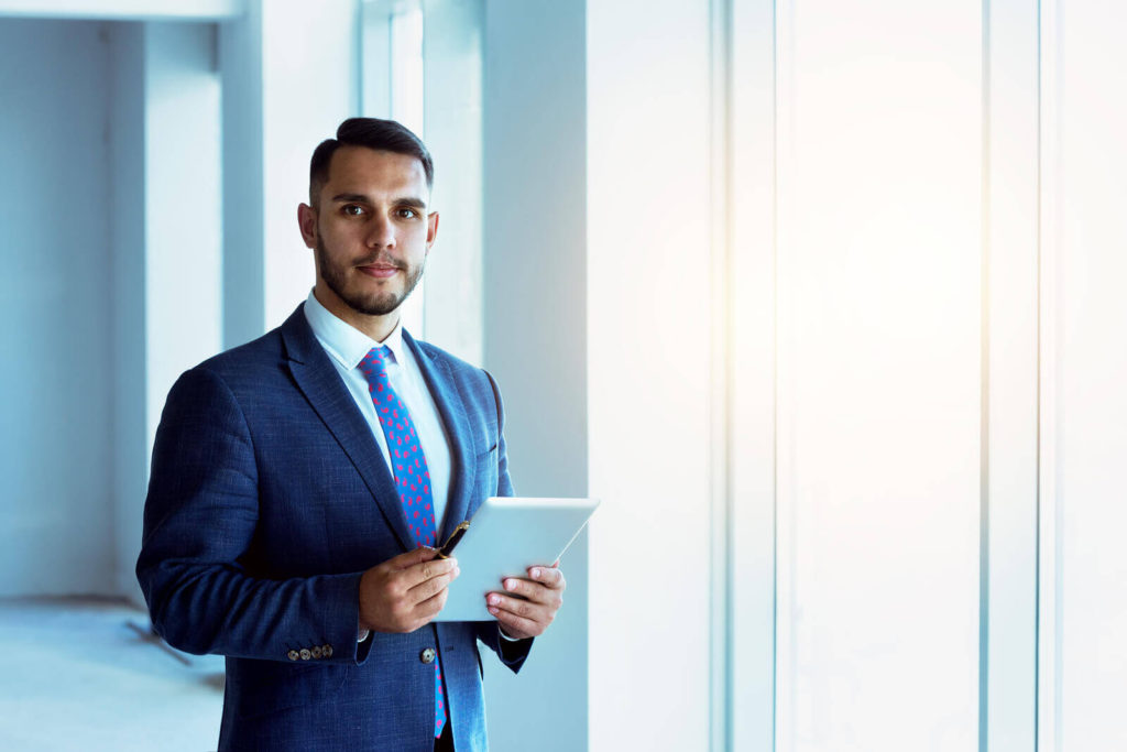 real estate professional holding a tablet computer